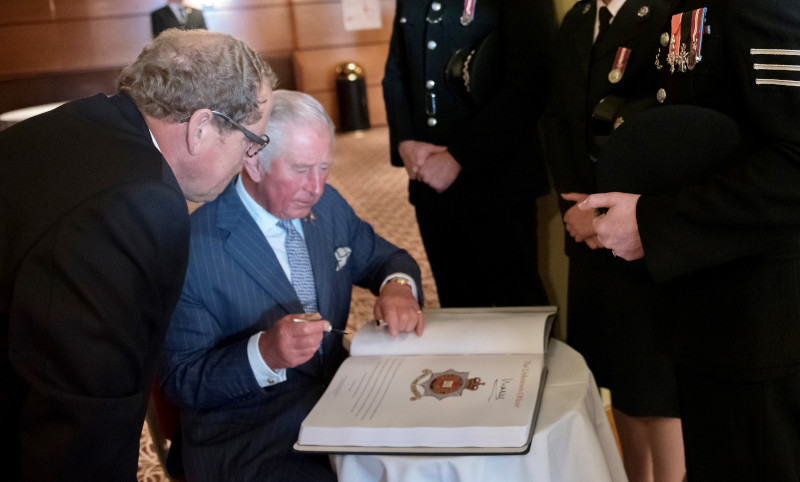 Prince Charles signs the Police Roll of Honour