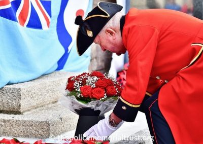 Colin Goad laying flowers at the War Memorial