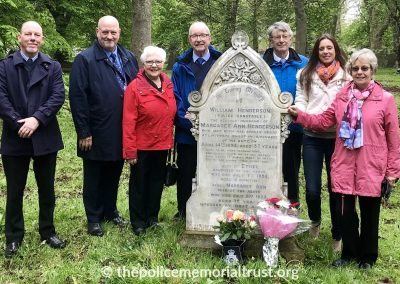 Family and Trust visit Officer's grave to lay flowers