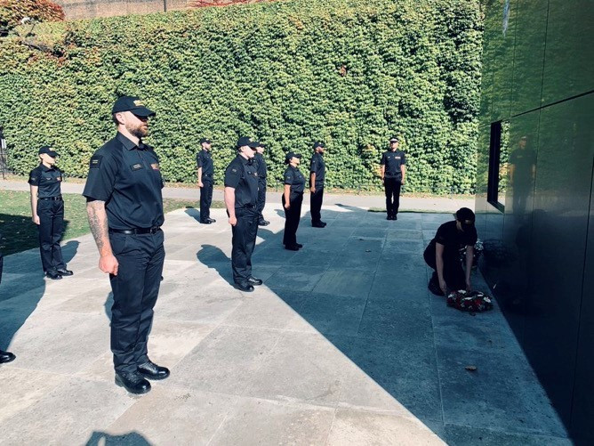 police officer laying a wreath at the national police memorial