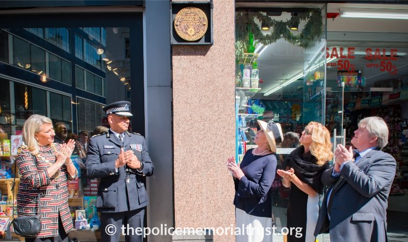 Geraldine Winner and police officer looking at Kenneth Howorth GM's Memorial