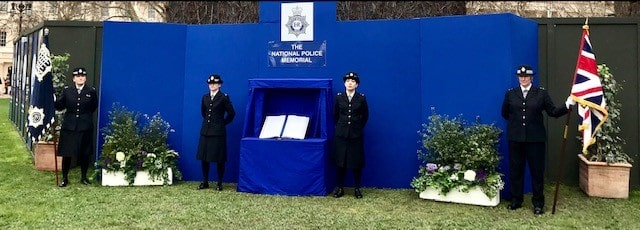 Female police officers standing by the temporary National Police Memorial