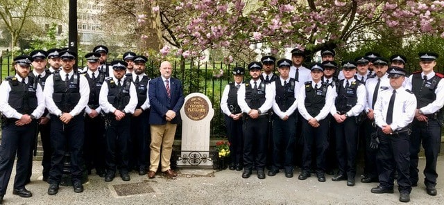 Group of police officers at WPC Yvonne Fletchers memorial stone min
