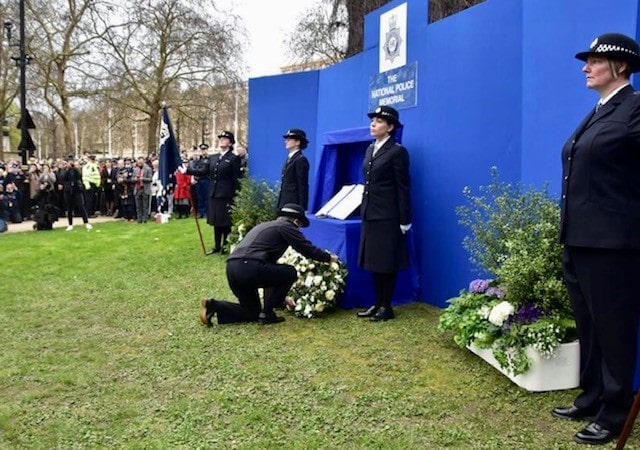 The police Commissioner laying a floral wreath